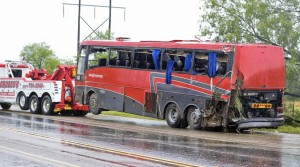 A damaged OGA Charters bus is hauled away after a fatal rollover on Saturday, May 14, 2016, south of the Dimmit-Webb County line on U.S. 83 North in Texas. (Laredo Texas, Nuevo Laredo Mexico out, Mandatory credit Danny Zaragoza | Laredo Morning Times.) ORG XMIT: TXLAR102